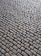 Old english cobblestones road in plymouth close up. Stock Photos