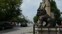 Bronze metal stone lion unicorn & China stone arch in front of ancient city gat Stock Footage