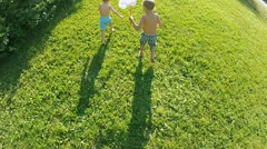Boys catches a butterfly Stock Footage
