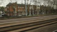 Stock Video Footage of Train travel UK. Past flats and houses.