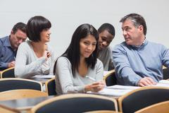 Students talking in lecture Stock Photos