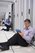 Technicians working on data stores - stock photo