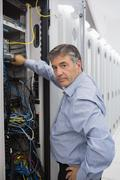 Technician working on data servers Stock Photos