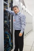 Stock Photo of Technician working and repairing a server