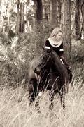 Woman in medieval dress on horseback Stock Photos