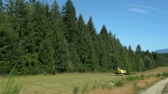 Rv landing on a grass strip Stock Footage