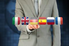 Businessman activating German flag on touchscreen Stock Photos