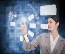 Stock Photo of Businesswoman`s finger pointing touch screen