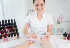 Manicure treatment at nail spa Stock Photos