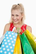 Portrait of cute young woman with shopping bags - stock photo