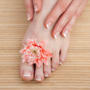 Stock Photo of French nail treatment at spa center
