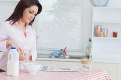 Stock Photo of Woman pouring cereal in bowl