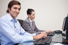 Stock Photo of Business colleagues using computers at office