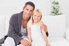 Stock Photo of Father and child looking at camera