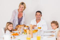 Stock Photo of Mother putting a turkey on the table