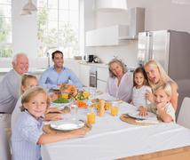 Happy family going to eat - stock photo