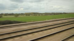 Stock Video Footage of British train travel in the countryside. Two shots.