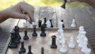Stock Video Footage of Active retired people, two senior men playing chess at park