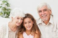 Grandparents with grandaughter Stock Photos