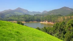 Mountain landscape with lake in Munnar Kerala India Stock Footage