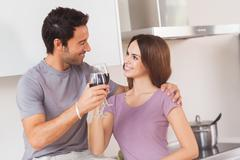 Lovers toasting with a glass of wine - stock photo