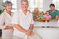 Portrait of grandparents with their family - stock photo
