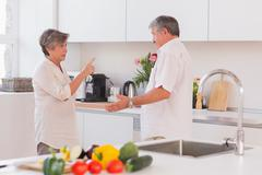 Old couple yelling in the kitchen Stock Photos
