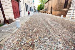 antique via degli angeli at autumn day in ferrara - stock photo
