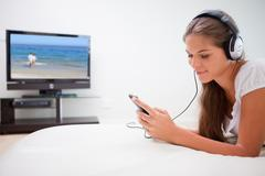 Stock Photo of Woman listening to music on her mp3 player