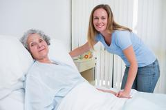 Woman holding the hand of a patient in a room Stock Photos