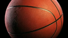 Basketball, Rotation on black background, loop - stock footage