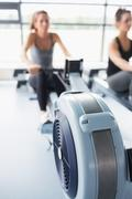 Rowing machine being used in gym Stock Photos