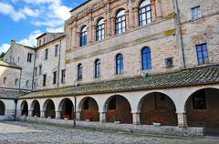 arcades of an old building - stock photo