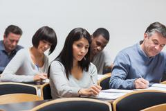 Students taking notes in lecture Stock Photos