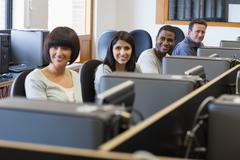 Stock Photo of Smiling group in computer class