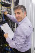 Data center worker checking the servers - stock photo