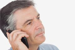 Businessman on call while looking away Stock Photos