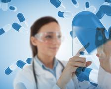 Smiling nurse holding a virtual screen Stock Photos