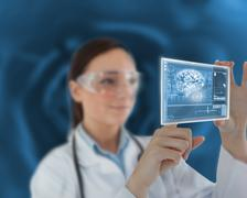 Nurse touching on virtual screen - stock photo
