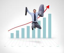 Successful businessman jumping before graphical presentation - stock photo