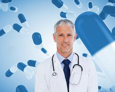 Smiling doctor with stethoscope - stock photo