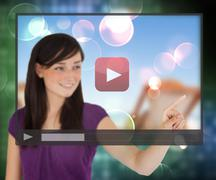Woman using video on touch screen - stock photo