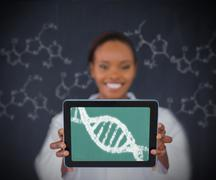 Woman showing DNA Helix - stock photo