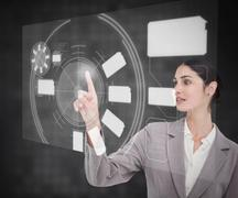 Stock Photo of Businesswoman working with touch screen