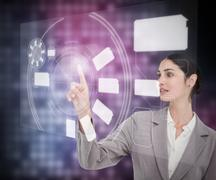Stock Photo of Brunette businesswoman using touch screen