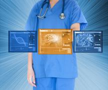 Doctor using touchscreen against blue background - stock photo