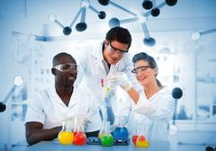 Group of chemist examining test tubes Stock Photos