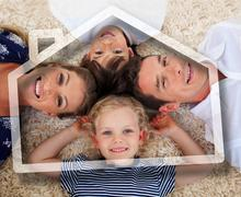 Smiling young family lying with heads together Stock Photos