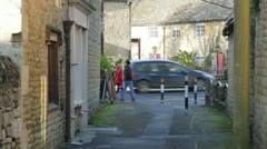 Country village lane people walk past Stock Footage