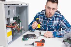 Computer engineer repairing cpu - stock photo